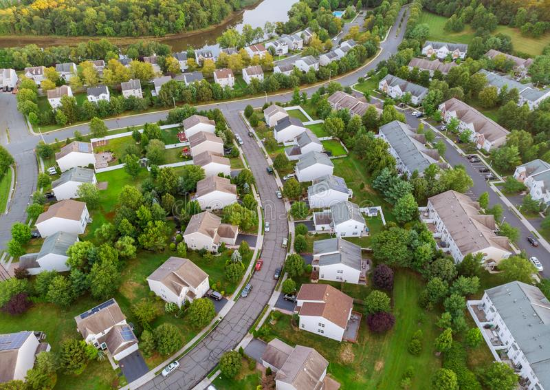 Aerial view over suburban homes and roads early sunrise. Aerial view over suburban homes and roads aerial view of residential early sunrise, neighbourhood stock photo