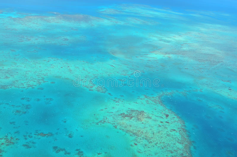 Aerial view of Oystaer coral reef at the Great Barrier Reef Que. Aerial view of Oystaer coral reef at the Great Barrier Reef near Cairns in Tropical North stock photos