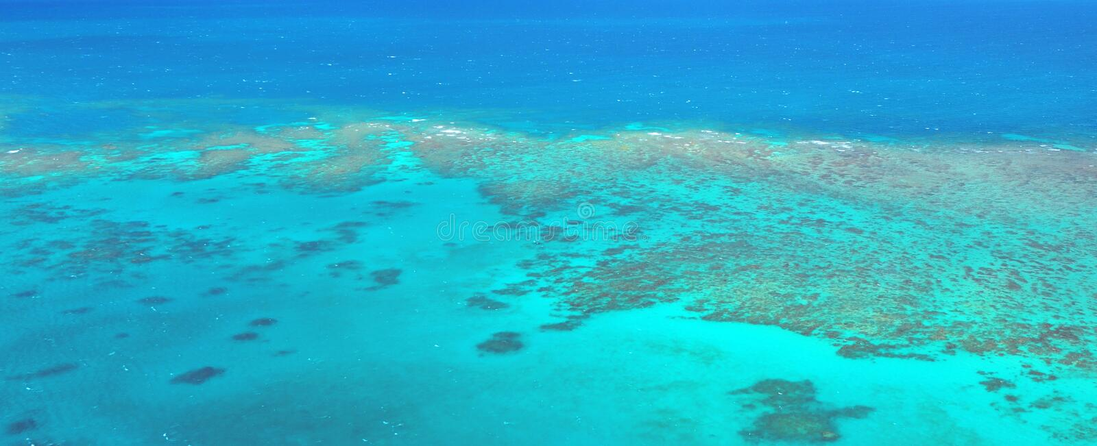 Aerial view of Oystaer coral reef at the Great Barrier Reef Que. Aerial view of Oystaer coral reef at the Great Barrier Reef near Cairns in Tropical North royalty free stock photos