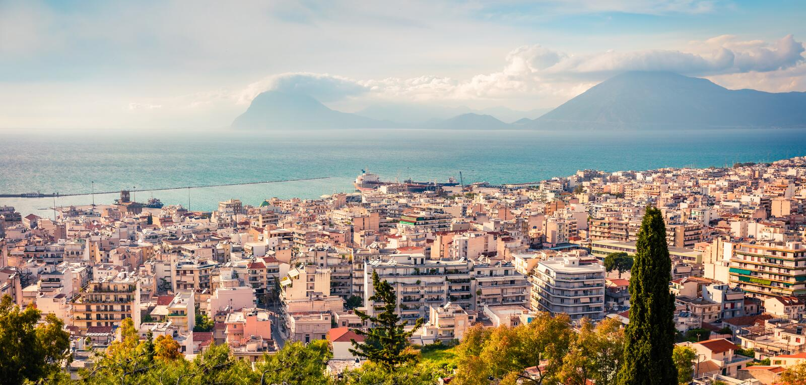 Aerial view of Paleo Patras city. Colorful spring morning on the Ionian Sea. Beautiful cityscape panorama of Greece town. stock photo
