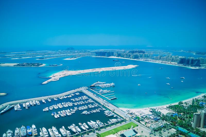 Aerial view of Palm Jumeirah Island with luxury yachts in the front. royalty free stock photos