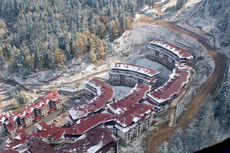 Aerial view - Pamporovo ski Resort - Bulgaria. Ski resort Pamporovo at the first snow - Bulgaria. New hotels buildings. Aerial view royalty free stock image