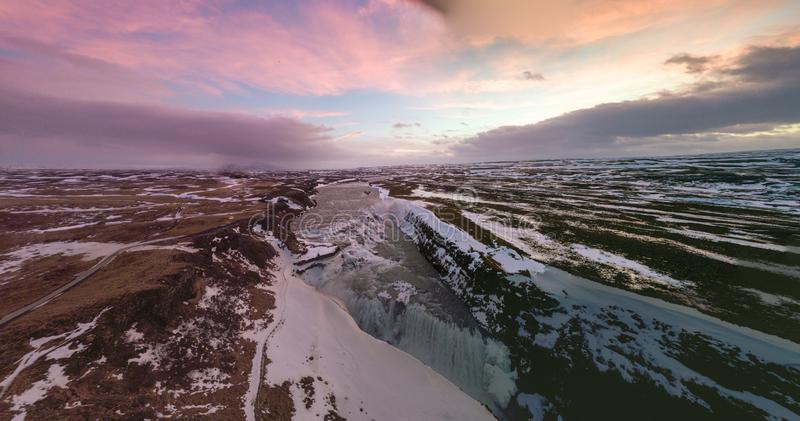Aerial view panorama of Gullfoss waterfall with pink dawn sky in Iceland /waterfall / panorama view / drone photography.  stock photos