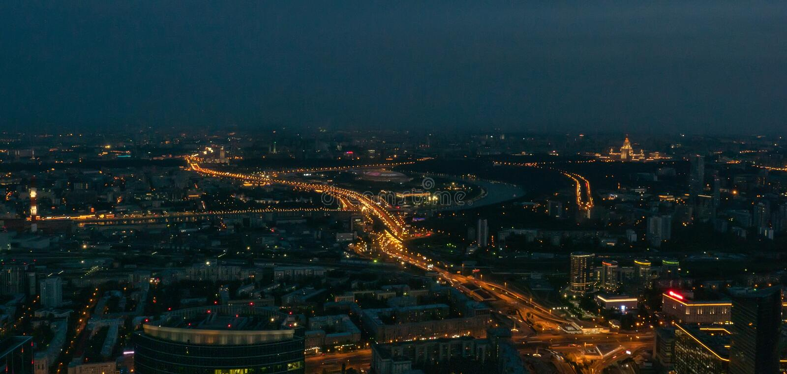 Aerial view panorama of night city Moscow, Russia. Urban cityscape after sunset with illuminated streets and building stock image