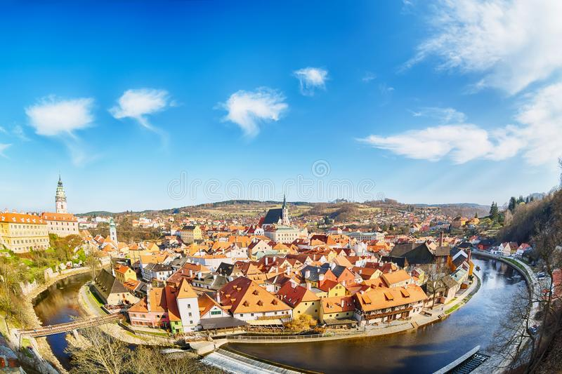 Aerial view panorama of the old Town of Cesky Krumlov in South Bohemia, Czech Republic with blue sky. UNESCO World heritage Site a royalty free stock photo