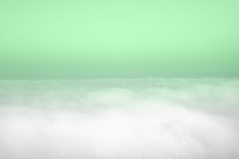 Aerial view of panoramic horizontal clear sky above clouds. Trendy mint toned surreal image. Year color concept, scenery, simple, copy, space, unreal, idyllic stock photography
