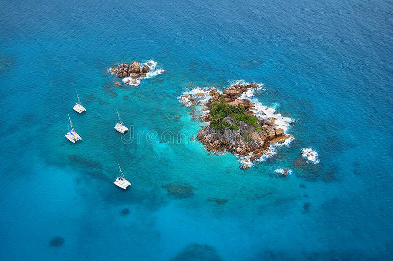 Aerial view of a paradise island with boats royalty free stock photos