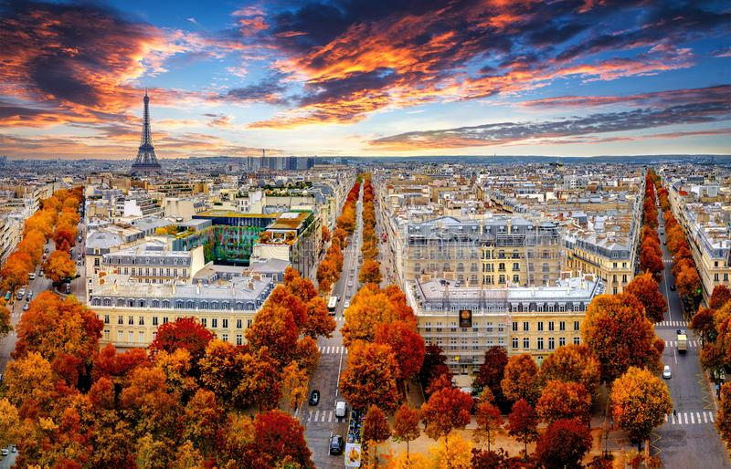 Aerial view of Paris in late autumn at sunset.Red and orange colored street trees. Eiffel Tower in the background. Paris stock images