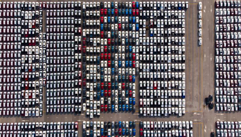 Aerial view of a parking lot new cars lined up in the port for i royalty free stock image