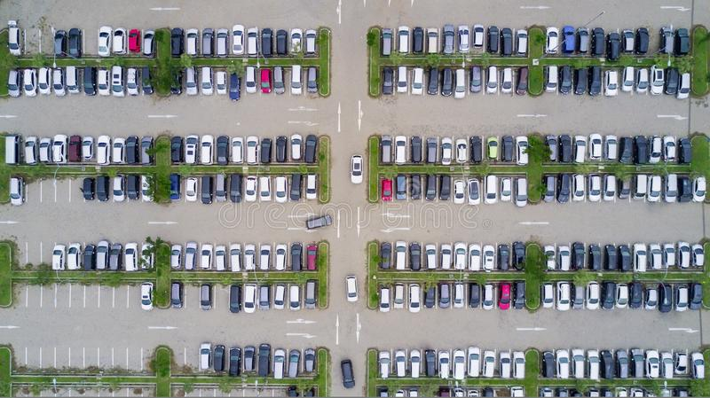 Aerial view of a Parking lot shot from a drone. Aerial view of a crowded parking lot with many cars shot from a drone stock photo