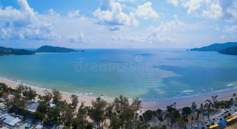 Aerial view of Patong beach, Phuket island and sea in summer, and urban city with blue sky for travel background, Andaman ocean, stock image