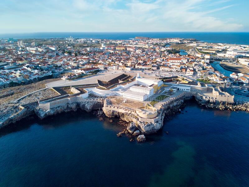 Aerial View Of Peniche Fortress And City At Sunset. Aerial View Of Fortress and Cityscape of Peniche, Portugal. Drone shot of the old prison royalty free stock photography