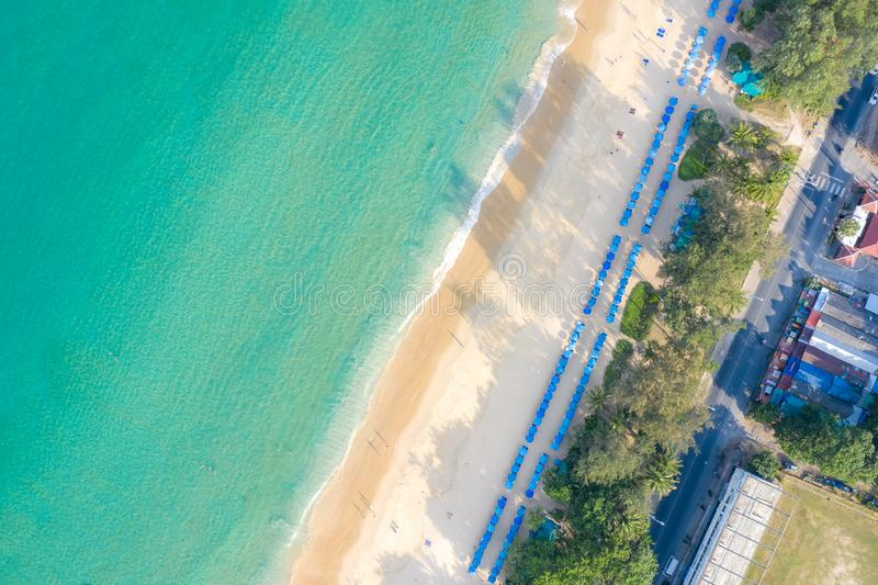 Aerial view of people swimming on the pink swim ring in the transparent turquoise sea in Phuket, Thailand stock photo