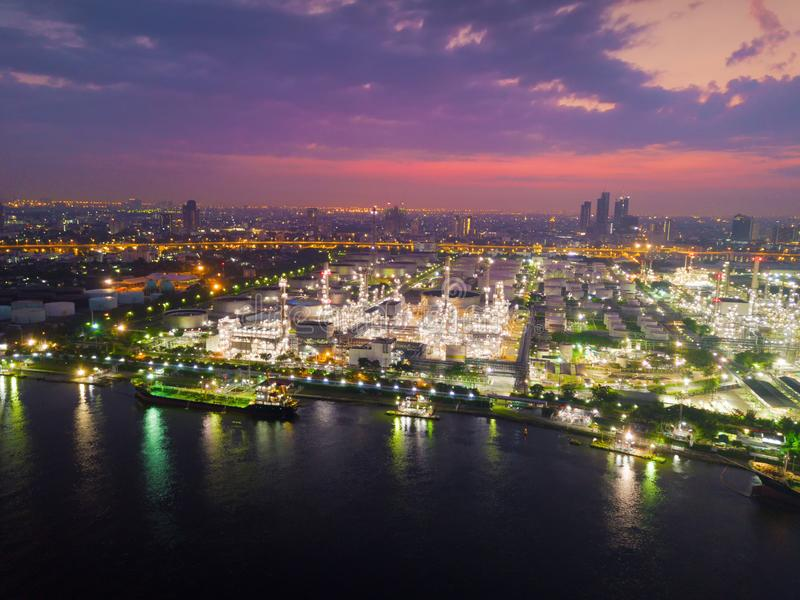 Aerial view of Petroleum`s oil refinery in industrial engineerin. G concept. Oil and gas tanks industry at sunset. Modern factory stock image