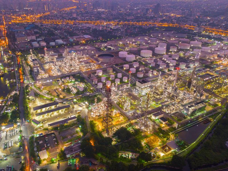 Aerial view of Petroleum`s oil refinery in industrial engineerin. G concept. Oil and gas tanks industry at sunset. Modern factory royalty free stock image