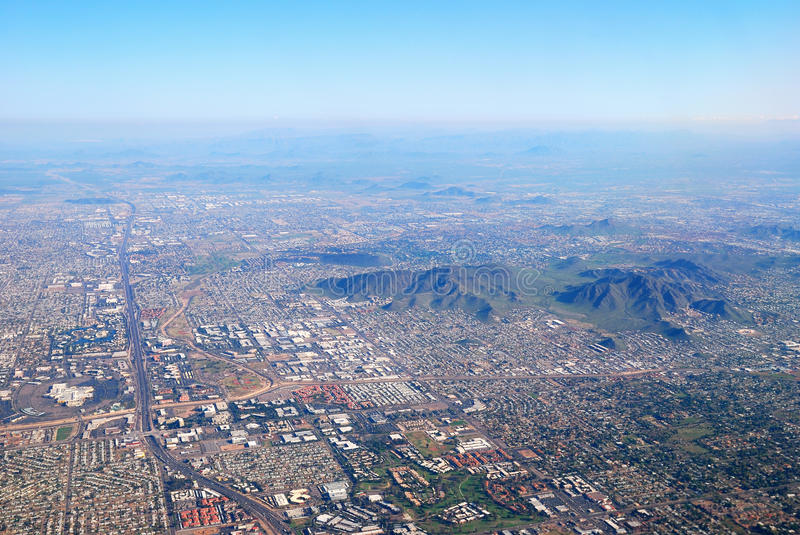 Aerial view of Phoenix city, Arizona. Aerial view of Phoenix city with buildings and CamelBack mountain in Arizona royalty free stock image
