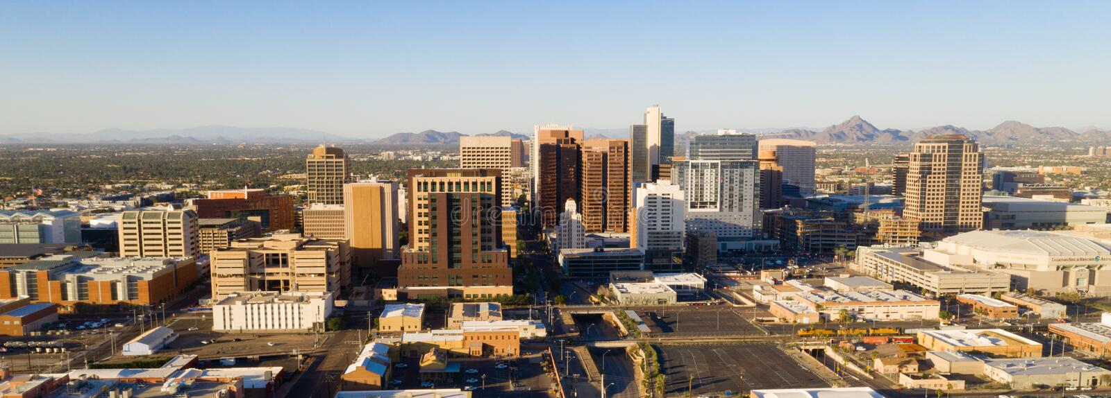 Aerial View Phoenix State Capital City of Arizona Downtown City Skyline. Late afternoon sun lights the buildings in the downtown urban core of Phoenix Arizona stock images
