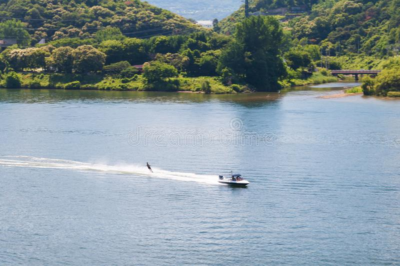 Aerial view photo of high speed water ski towed by speed boat in river stock photos