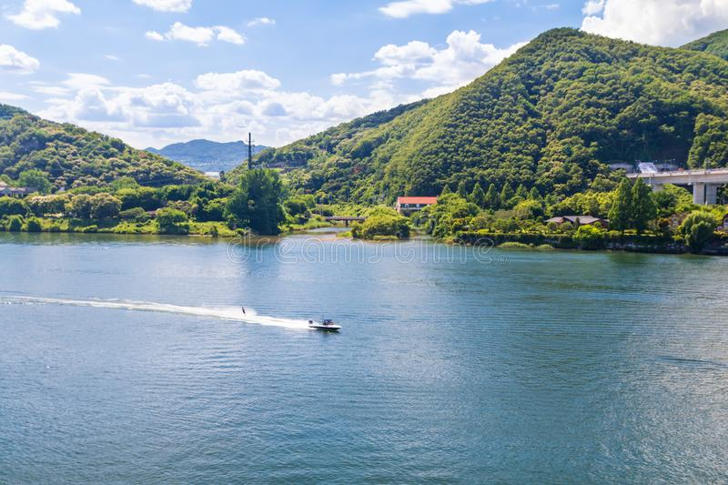 Aerial view photo of high speed water ski towed by speed boat in river. Korea stock photos