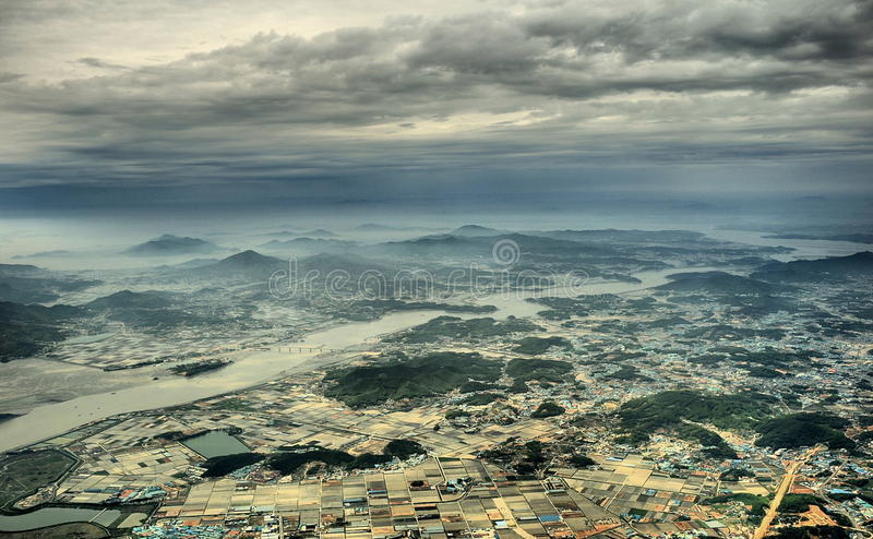 Aerial View Photo of Urban Area and Mountain Range in the Distance Under Gray Cloudy Sky stock photos
