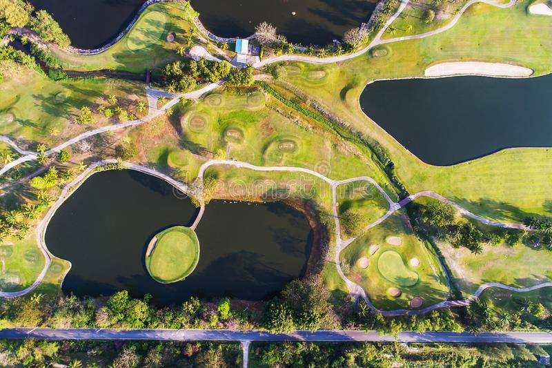 Aerial view photography of forest and golf course with lake. royalty free stock photo