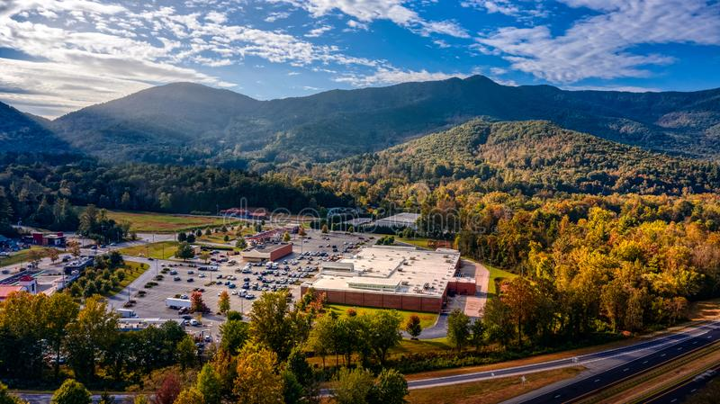 Aerial view picturesque Asheville neighborhood during the Fall with colors starting to show and Sun Rays stock images