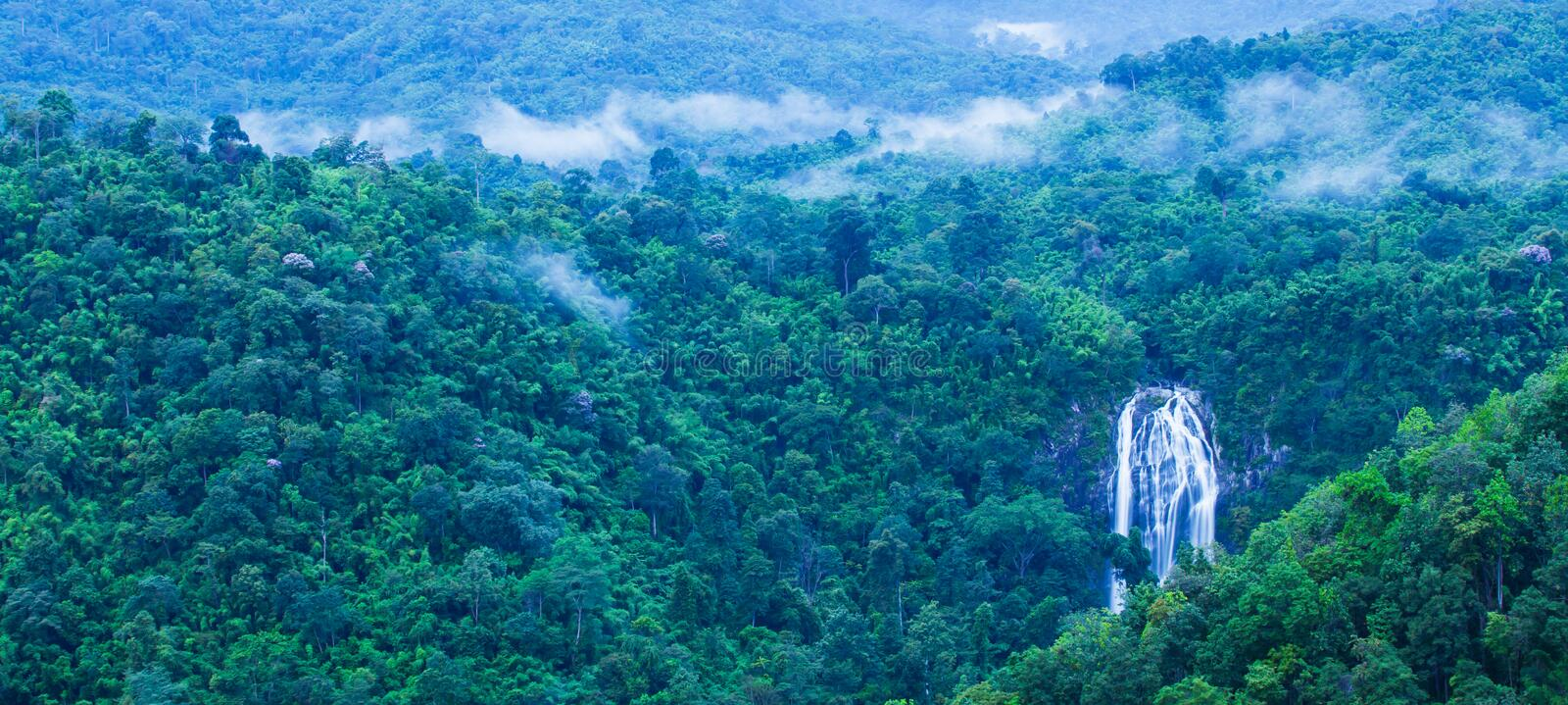 Aerial view of picturesque waterfall in blue mist royalty free stock photos