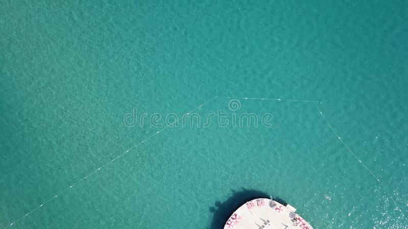 Aerial view on pier of luxury hotel, blue sea background. Video. Aerial top view water villa at Maldives island. Beautiful tropical Maldives resort hotel. Top royalty free stock photos