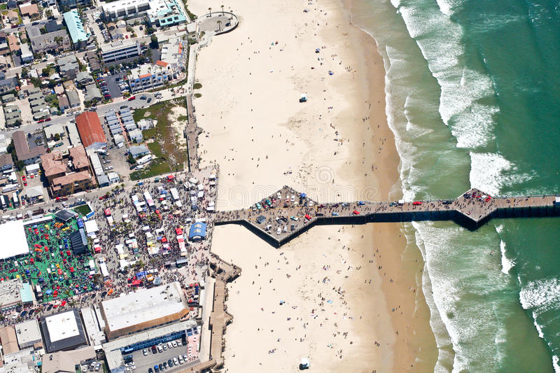 Aerial view of pier at Pismo Beach, CA. Aerial shot of pier at Pismo Beach, California. An annual car show is taking place and the crowds are visible on the pier stock photo