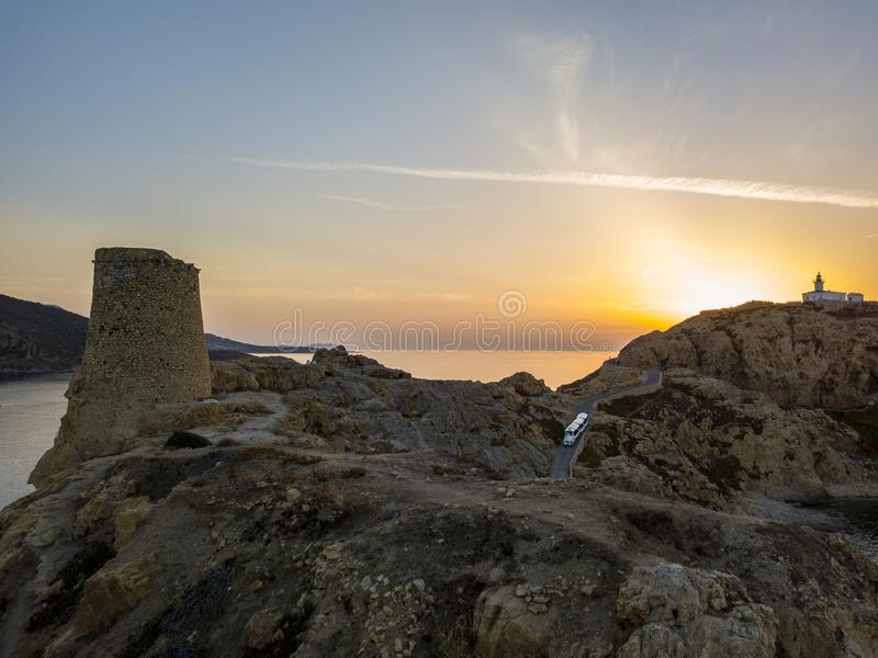 Aerial view of the Pietra Lighthouse and the Genoese tower at sunset. Red Island, Corsica, France royalty free stock images