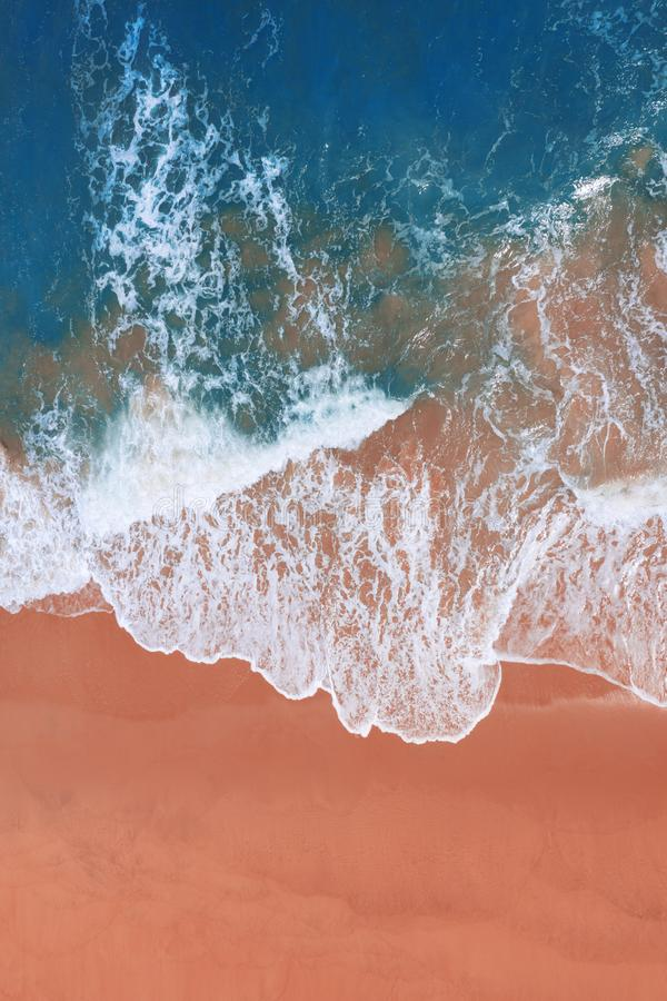 Aerial view of pink beach and blue ocean wave. Aerial view of pink beach and blue ocean wave stock images