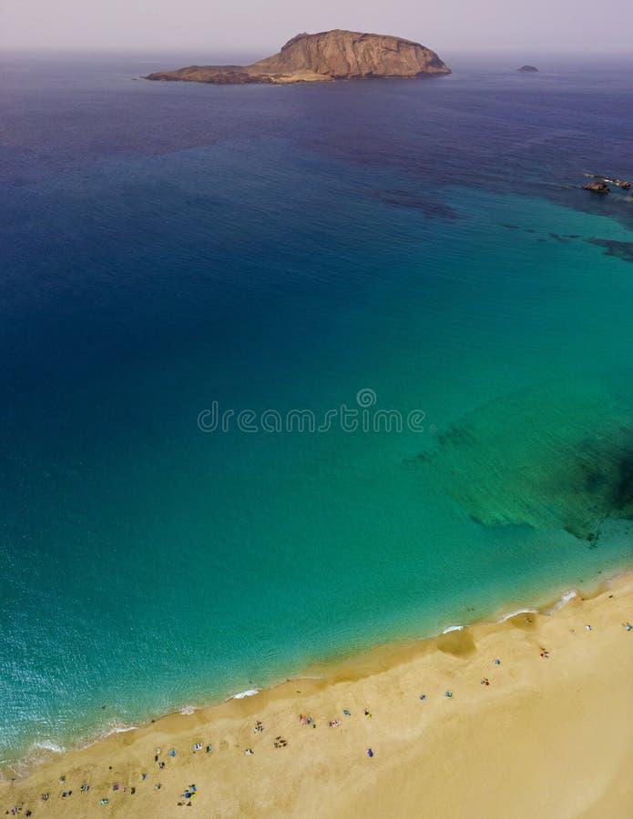 Aerial view of the Playa de las Conchas, La Graciosa island in Lanzarote, Canary island. Spain. Ocean view and sand beach stock images