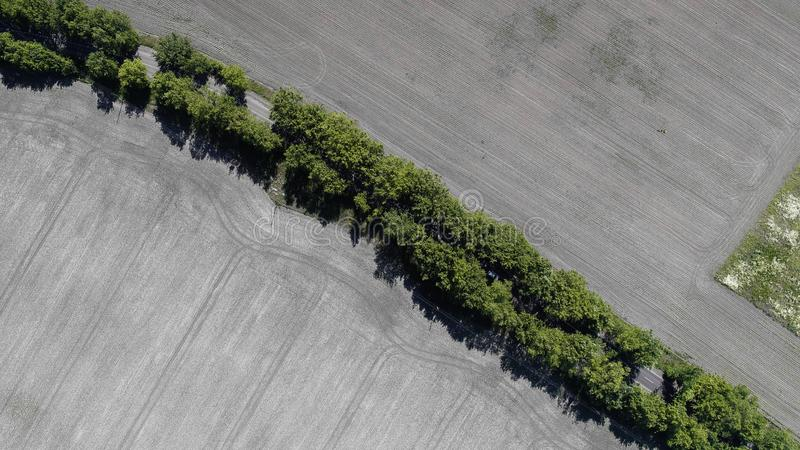 Aerial view of the plowed field royalty free stock images