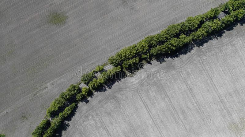 Aerial view of the plowed field royalty free stock photo