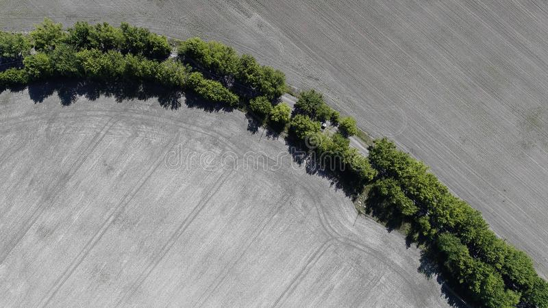 Aerial view of the plowed field stock photos