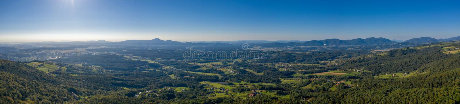 Aerial view from Pohorje on Soouth East Slovenia, Styria region. Towns of Slovenska Bistrica, Oplotnica and Slovenske Konjice, Haloze and Boc in background stock photo