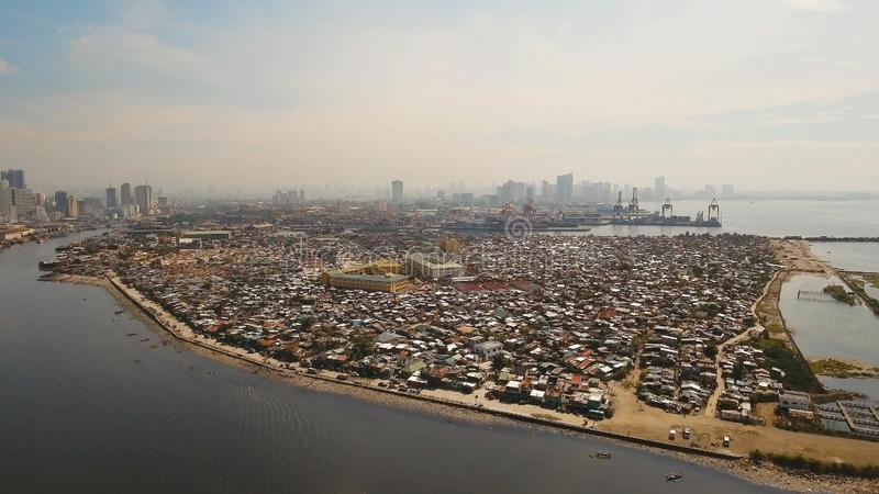 Aerial view slums of Manila, the poor district. Philippines, Manila. Aerial view poor district of Manila slums, ghettos, wooden old houses, shacks. Slum area of stock photography