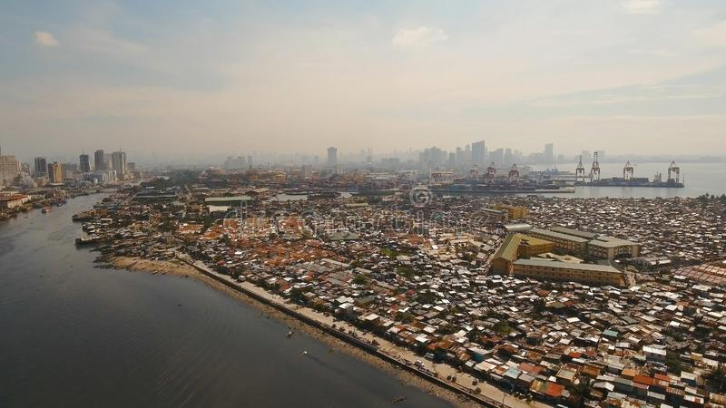 Aerial view slums of Manila, the poor district. Philippines, Manila. Aerial view poor district of Manila slums, ghettos, wooden old houses, shacks. Slum area of stock photo