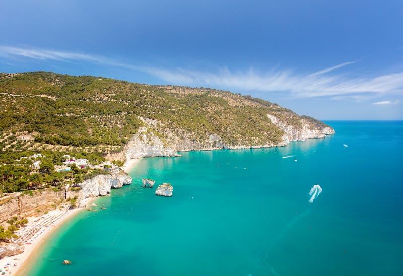 Aerial view of popular scenic touristic spot in Puglia, Italy - Faraglioni di Puglia, Baia delle Zagare, Apulia region. Captivating turquoise seascape of stock photos