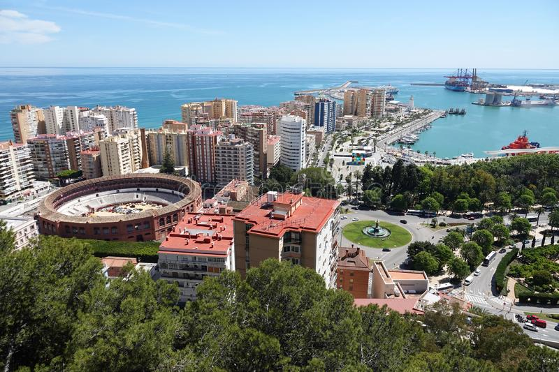 Port and Plaza de Toros de La Malagueta in Malaga, Spain. Aerial view of the port of the city of Malaga with Bullring arena Plaza de Toros de La Malagueta at the royalty free stock image