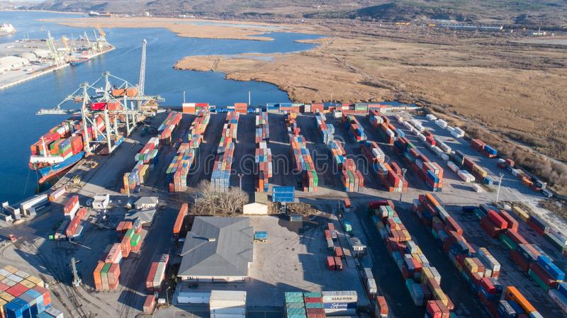 Aerial view of port container terminal. Industrial cargo harbor with ships and cranes royalty free stock images