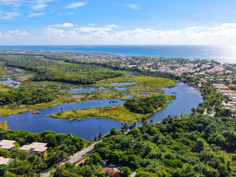 Aerial view of Praia do Forte, Bahia, Brazil coastline and tropical forest royalty free stock photo
