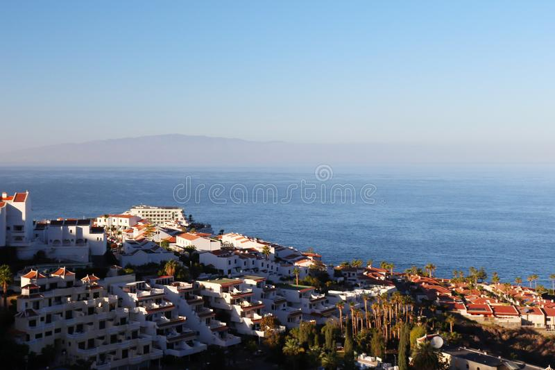 Aerial view of Puerto de Santiago, Spain. Overlooking the town of Puerto de Santiago with a view of La Gomera Island and the Atlantic Ocean on a bright, sunny royalty free stock images
