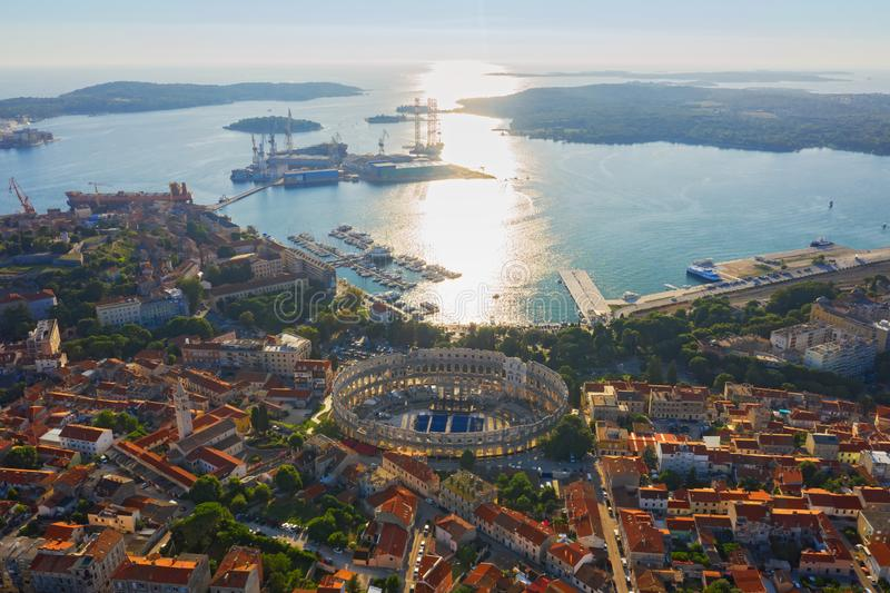 Aerial view of Pula in Croatia with Roman Amphitheatre, marina and port at sunset. Istria, Europe stock image