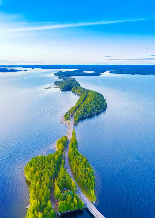 Aerial view of Pulkkilanharju Ridge, Paijanne National Park, southern part of Lake Paijanne. Landscape with drone. Blue. Lakes, road and green forests from royalty free stock photo