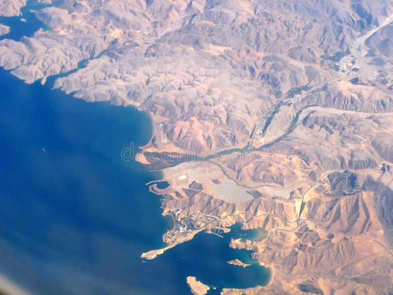 Aerial View Qaboos Port Oman. Aerial View of Oman Coastline taken from 35000 ft in the Air showing Qaboos Port & Surroundings stock image