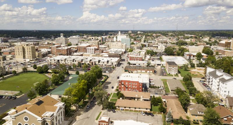 Aerial View Quaint Charming and Humble Over Springfield Missouri. The downtown city skyline and buidlings of Sprigfield MO under partly cloudy skies aerial royalty free stock photo