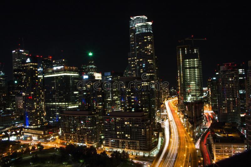 Aerial View of Queens Quay West in Toronto. Aerial View of Queens Quay West and modern buildings at night, at the Harbourfront in Toronto, Ontario stock photos