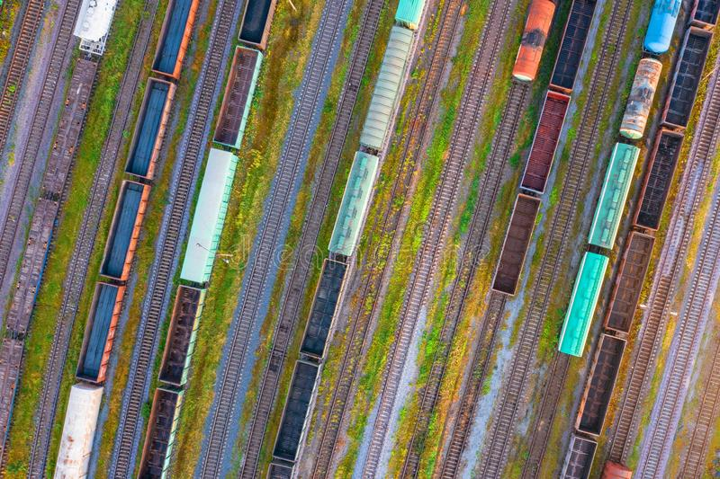 Aerial view of rail sorting freight station with railway cars, with many rail tracks railroad. Heavy industry landscape on evening. Sunset light stock photo