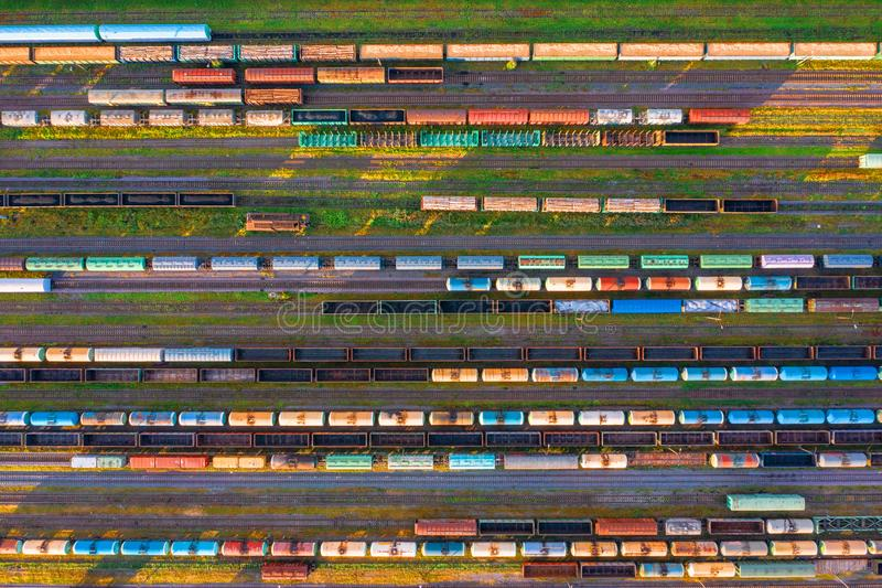 Aerial view of rail sorting freight station with railway cars, with many rail tracks railroad. Heavy industry landscape on evening royalty free stock images